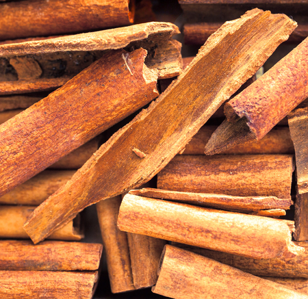 obtained: Close up background of dried stick cinnamon, a spice obtained from the inner bark of several trees from the genus Cinnamomum, used as a savoury spice and seasoning and flavouring in baking and cooking Stock Photo