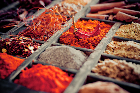 Close-up of different types of Assorted Spices in a wooden box. Stock Photo