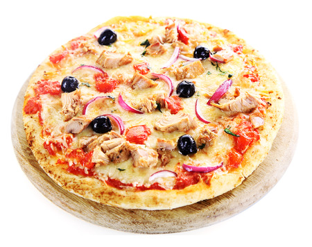Pizza over a pizza board isolated on white background with tuna fish, onions and olives photo