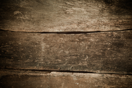 vignetting: Background of old weathered and textured wooden planks with side vignetting