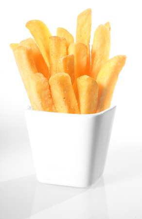quick snack: White ceramic container of crispy French fries or deep fried potato batons or chips on a white background Stock Photo