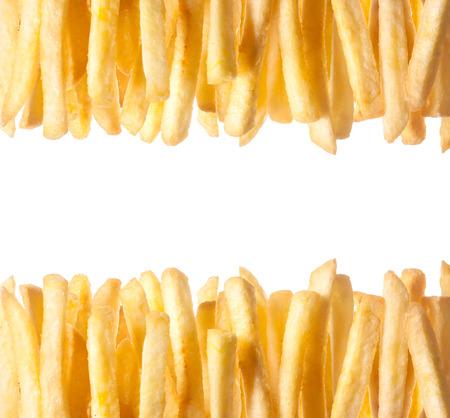 上部との間の copyspace と白で隔離されるフレームの下部に沿って 2 つの行に配置された鮮明な黄金フランスフライドの境界線 写真素材