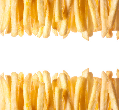 Border of crisp golden French Fries arranged in two rows along the top and bottom of the frame isolated on white with copyspace between 版權商用圖片