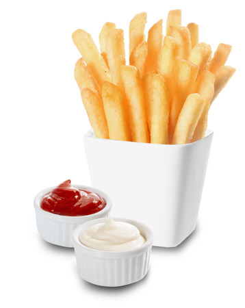 calory: Crisp golden French Fries or fried potato chips served with individual containers of creamy mayonnaise and tomato ketchup on a white background