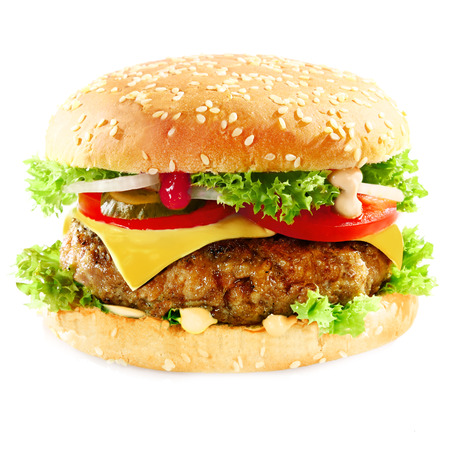 Close-up of a tasty hamburger sandwich containing: cooked patties of ground meat, onion, tomatoes, cheese, fresh green salad and pickles