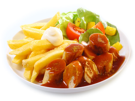Mantaplatte topped with gravy or BBQ sauce served with golden French fries and fresh mixed leafy green salad on white photo