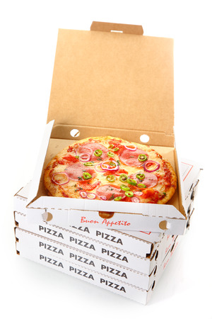 pizza delivery: Whole pepperoni pizza in an open cardboard takeaway pizza box waiting for delivery from the pizzeria to a customer at home Stock Photo