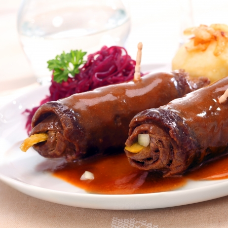 roulade: Cooked roulades or rouladen, a speciality dish of thinly sliced rolled beef around a vegetable or pickle filling cooked in a marinade or gravy