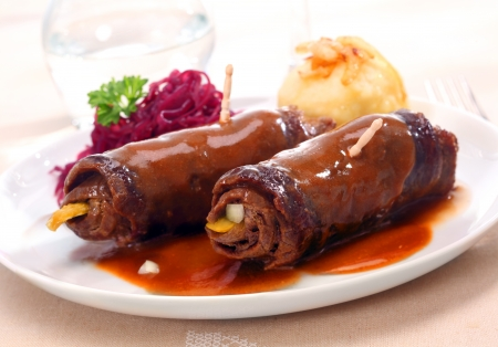 Two tasty cooked roulades made from thinly sliced beef or veal rolled around a filling of diced vegetables or pickles and braised in the oven in a marinade or sauce