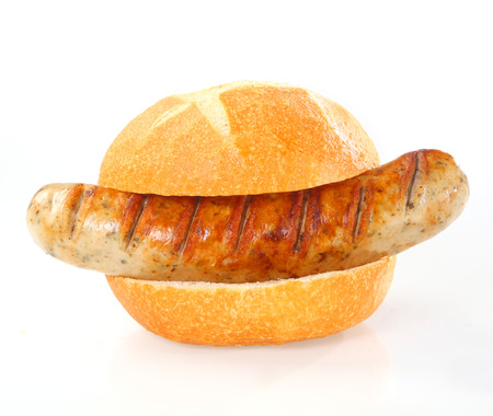bratwurst: Whole delicious grilled smoked sausage served as a hot dog on a fresh white bun or roll Stock Photo