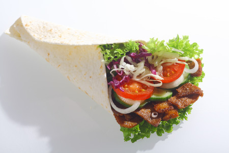 Doner or corn taco wrap filled with grilled meat and fresh salad filling