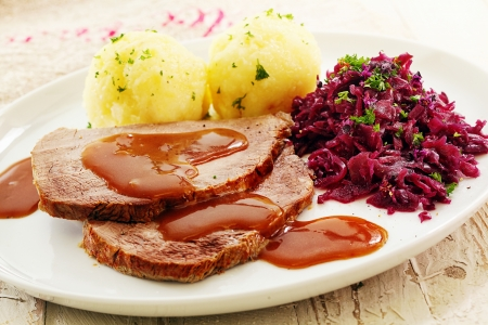 rump steak: Sliced roast cap of rump topped with a rich brown gravy and served with sauerkraut and potato for a traditional German meal