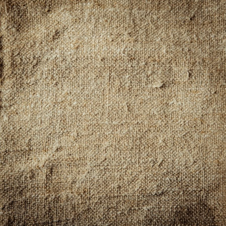 tissue texture: Background of grungy natural hessian with a coarse woven texture, frayed rough surface and natural fibre