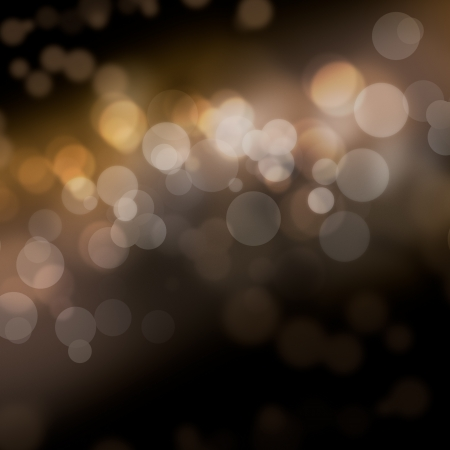 brownish: Abstract bokeh background of diffuse de-focused spherical lights on a dark background with copyspace