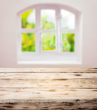 clean window: Empty scrubbed clean rustic wooden kitchen table under a pretty white domed window Stock Photo