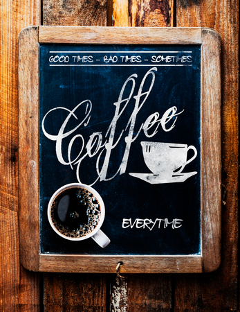 bad times: Cup of espresso coffee on a catchy sign saying - Good times, Bad times, Sometimes - Coffee Everytime - on an old school slate in a rustic coffee house or cafeteria