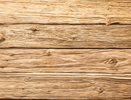 distressed wood: Rustic background of very rough textured weathered wooden planks with knots in a horizontal parallel pattern Stock Photo