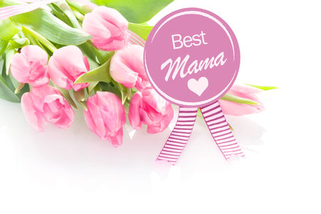 tribute: Heartwarming Mothers Day greeting - Best Mama - from a child on a round purple rosette with a gift of a bouquet of fresh pink tulips