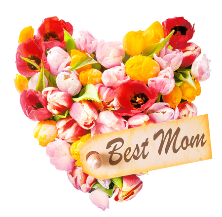 Mothers Day heart-shaped greeting with an arrangement of beautiful mulitcoloured fresh tulips isolated on white with a gift tag reading - Best Mom - a tribute from a child to its mother photo