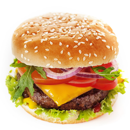 topped: Close-up of a tasty cheeseburger made of green salad and ground meat patty topped with sliced tomato, onion, cheese, parsley and sweet ketchup, placed inside a sliced hamburger bun with sesame
