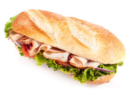 Fresh salad with chicken on a crusty golden French baguette for a healthy snack or meal, closeup angled view on white photo