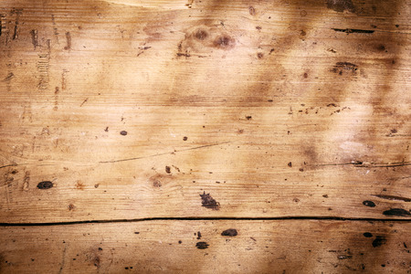 Vintage wooden background texture with worn smooth planks with stains and a vignette in the form of shadows photo