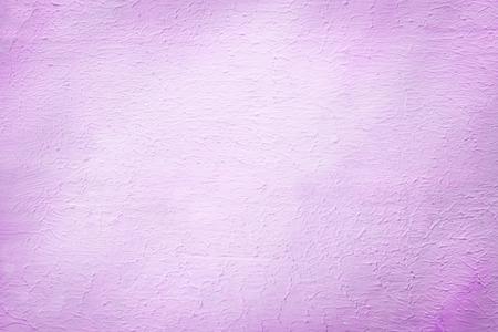 stippled: Architectural background of a rough plaster texture with a stippled effect in a pretty shade of lilac or light purple in a 2014 fashion color with light vignetting and copyspace