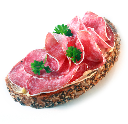 Healthy sandwich with salami and whole grain bread photo