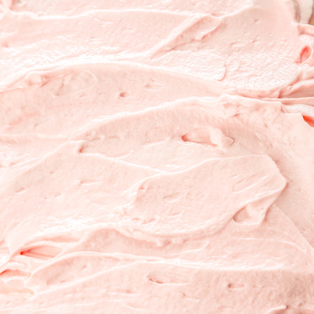 Creamy pink berry ice cream or frozen yoghurt background for a delicious cold summer treat, texture detail