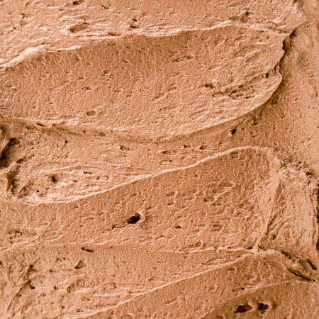 Instant chocolate ice-cream background with a creamy texture in square format for a delicious summer dessert or takeaway at an ice cream parlour