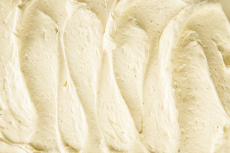 Background texture of creamy vanilla ice-cream or frozen yoghurt viewed close up from above , suitable for an ice cream parlor, bar, restaurant or for a tasty homemade dessert photo