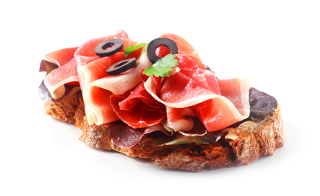 thinly: Thinly sliced gourmet dry-cured traditional German or Bavarian ham on rye bread with sliced olives