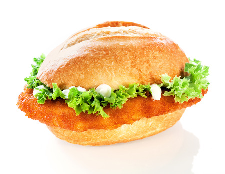 crusty: Delicious crusty fish burger or roll with a golden fried crumbed fish fillet and crinkly lettuce topped with mayo on a white background