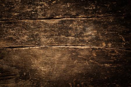 古い素朴な風化グランジのバック グラウンド テクスチャひび側ビネットと木材