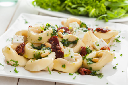 stuffed tortellini: Stuffed Italian tortellini pasta noodles with feta cheese, fresh basil and pine nuts served with a leafy green salad