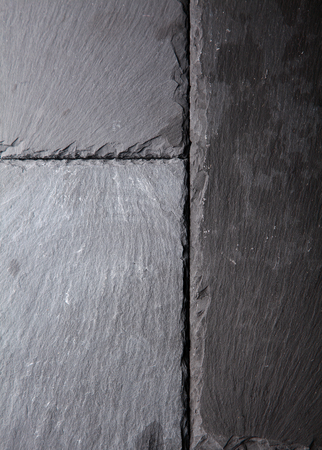 dark grey slate: Textured background pattern of natural dark grey slate tiles abutting each other with rough surfaces and slightly chipped edges Stock Photo
