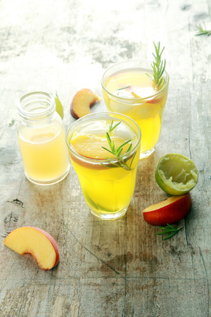 mouthwatering: Mouthwatering Yellow Fruit Juices on Wooden Table Ready to Drink. Healthy Drink for Detoxifying