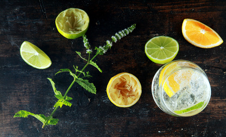 anti oxidants: Preparing Lemon Water on Wooden Table for Meal. Source for Anti Oxidants Stock Photo