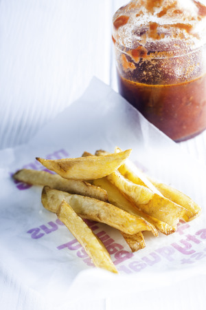 carbohydrates: Tasty Homemade French Fries with Ketchup on White Table. Good Source for Carbohydrates.
