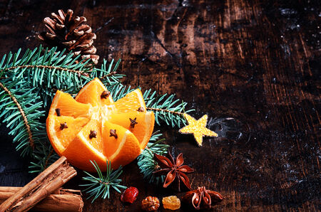 Holiday Fruit with Christ Decorations on Wooden Table photo