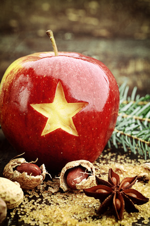 Closeup Carved Star in Sweet Red Christmas Apple. Holiday Fruit. photo