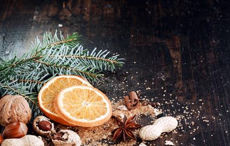 desiccated: Sweet Sliced Orange for Christmas on Wooden Table. Stock Photo