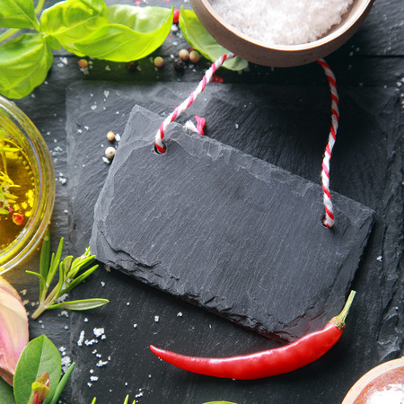 Small Black Wooden Tag with Red Chili Pepper on Table photo
