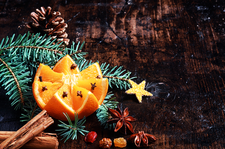 Holiday Orange with Christmas Decorations on Wooden Platform photo