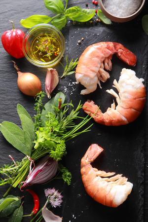 preparing food: Yummy Shrimp Meat with Ingredients, Ready for Cooking, Isolated on Black Table Background