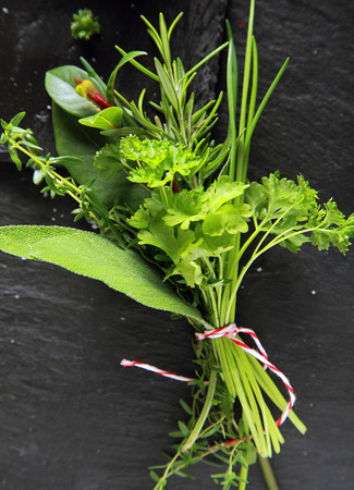 potherb: Bouquet garni of assorted fresh herbs tied in a bunch with chives, rosemary, parsley, oregano and coriander for use as an aromatic seasoning in cooking