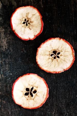 christamas: Three Fruit Slices on Vintage Black Wooden Table