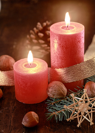 Lighted candles on decorated table - Christmas concept photo
