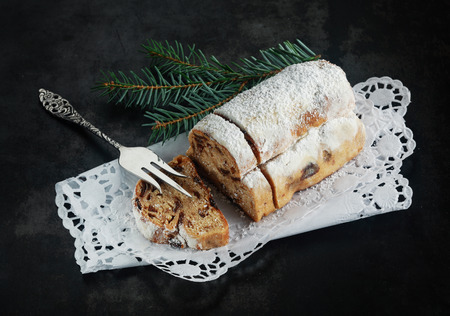 st nicholas: Christmas fare with a high angle view of a loaf of panettone bread, a speciality sweet bread made with spices and topped with powdered sugar for the festive season Stock Photo