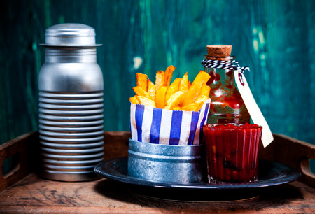 Tasty Homemade French Fries with Ketchup and Salt on Side. Good Source for Carbohydrates. photo